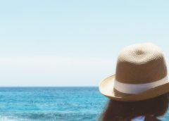 Girl with cute hat on beach
